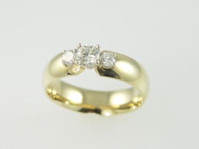 14KT Y/G Three Stone Diamond 0.69ct. - J- SI3 Band
