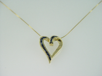 14KT Y/G Baggutte Saphirre 1l.75ct Channel Set Heart Pendant