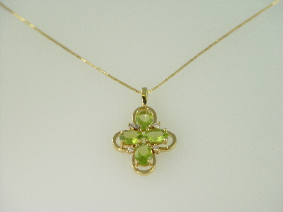 14KT Y/G Oval Peridot Cross 2.70ct and Diamonds 0.25ct