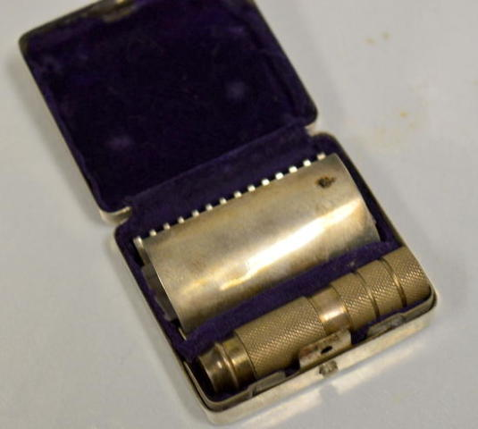 Vintage Travel Razor with Metal Case, Cooper is on the blade.