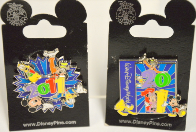 Disney 2011 Pins - One is a spinner -both have Mickey, Donald,Goofy and Pluto