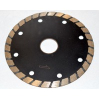 "Stone Cutting Diamond Blade, 4 1/2"" Across., 7/8"" Hole."