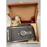Vintage Poleroid Professional Camera w/flash/light reducer/bulbs - no film.