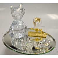 Crystal Creature: Bear, Owl on a golden limb, frog and a duck all on a mirror.
