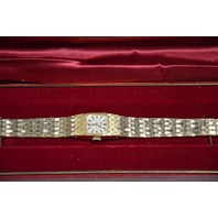 New  Ladie's Gold Tone Bracelet Watch, Stainless Steel Back.
