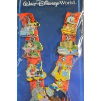 Disney Official Pin Trading Collection of 8 Pins and Lanyard.