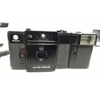 Minolta AF-C 35mm 1:2.8  Auto Focus Camera with EF-C Flash Attachment.