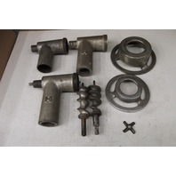 Assorted used meat grinder accessories.
