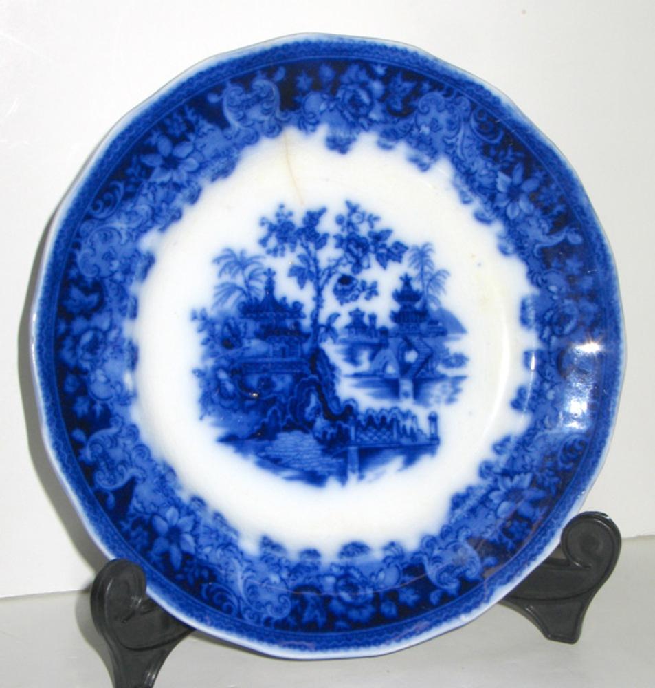 Antique flow blue wade co shanghai pattern