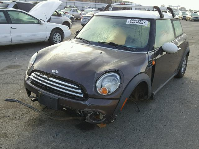 2012 Mini Cooper, 2dr, 1.6L, a/t, brown, hit front