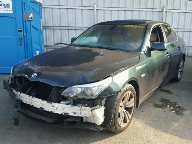 2010 BMW 528i, 3.0L, a/t,Sdn,green, hit front