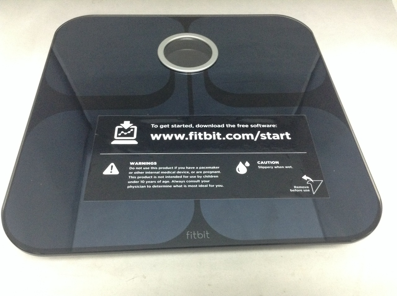 how to add aria scale to fitbit account