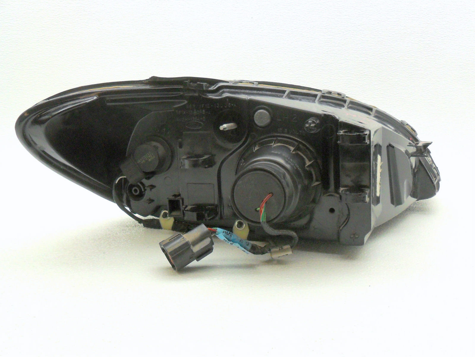 oem 2000 2007 ford taurus halogen headlight headlamp left. Black Bedroom Furniture Sets. Home Design Ideas