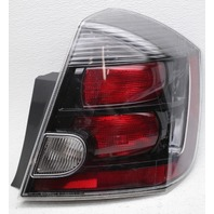 OEM Nissan Sentra SE-R Spec Outer Right Side Tail Lamp 26550-ET80C Lens Chip