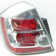 OEM Nissan Sentra Left Driver Side Tail Lamp Trim Chip 26555ET00B