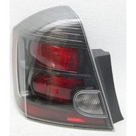 OEM Sentra SE-R Spec Left Driver Side Halogen Tail Lamp 26555-ET80C Lens Haze