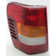 OEM Jeep Grand Cherokee Left Driver Side Halogen Tail Lamp 5101897AB Lens Chip