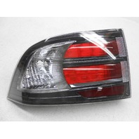 Non-US Market OEM Acura TL Left Tail Lamp Spots in Lens