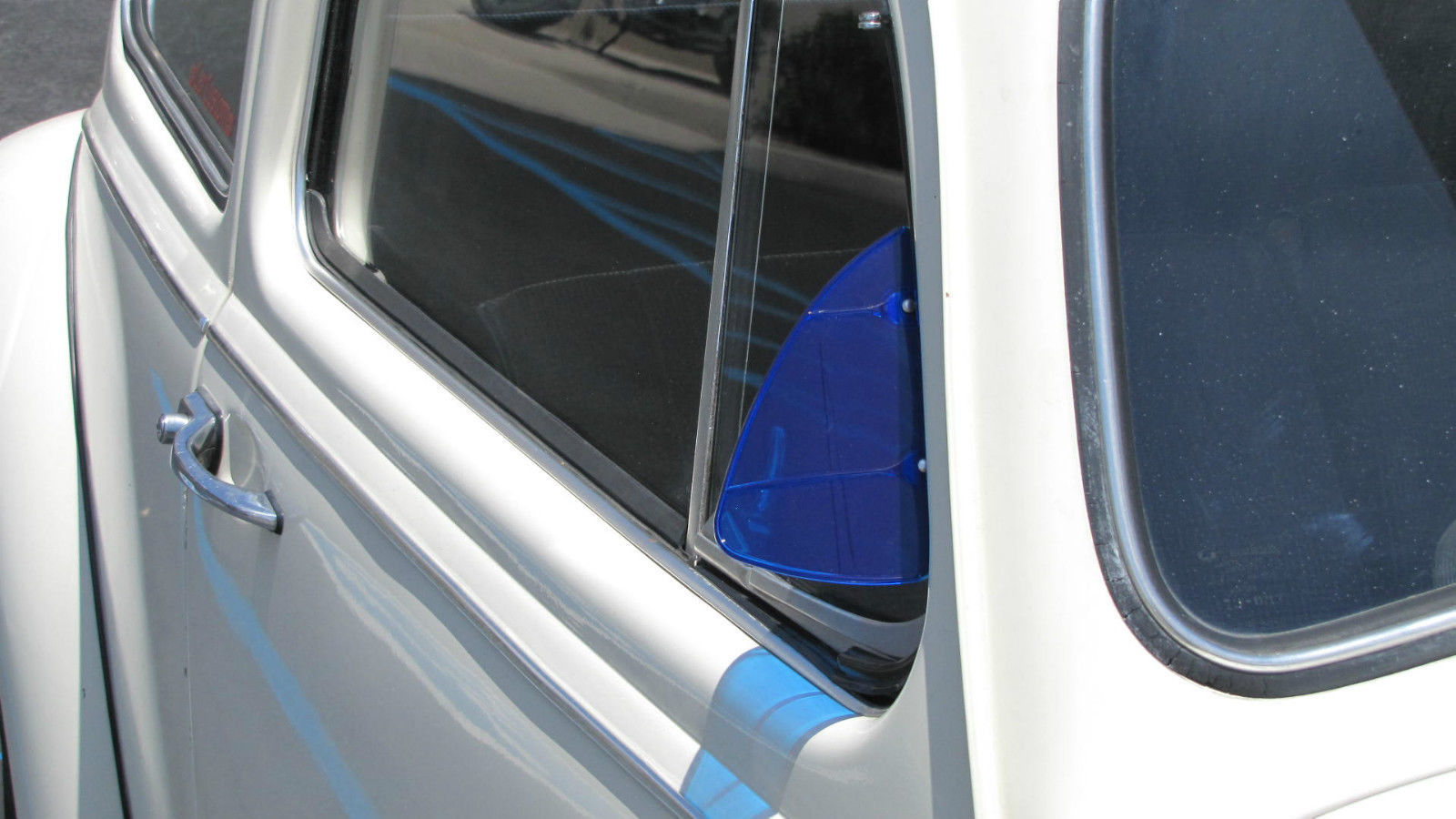Polished stainless steel vent wing window air deflector