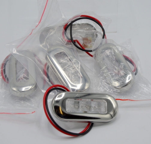 """5 - 12V Interior Blue LED Accent Lights- 3"""" ovals - 1 is missing the mounting screws."""