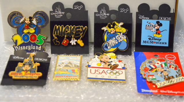 8 Disney Mickey Mouse Pins - All different areas. 03195