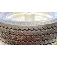 "Marathom Flat Free Tire - 4.10 / 3.50-4 Sawtooth Tread 3.5"" Centered - 5/8"" Bearing"