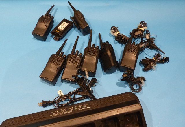 LOT OF 7 VERTEX EVX-531 TWO WAY RADIO W/ 1 6-BAY MULTI-CHARGER & 6* HEADSETS