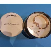 BCBGENERATION ROSE GOLD XOXO CHARM BRACELET W/EARRING SET
